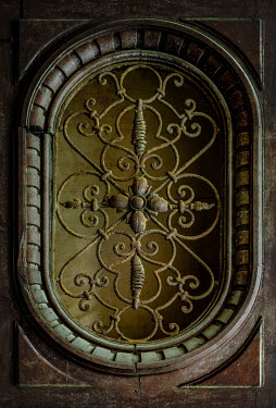 Jaroslaw Blaminsky CLOSE UP OF RUSTY ORNATE DOOR Building Detail