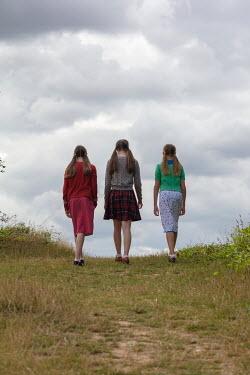 Stephen Mulcahey THREE GIRLS IN COUNTRYSIDE FROM BEHIND Women