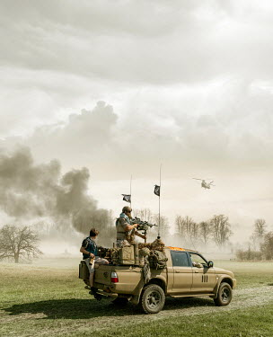 Stephen Mulcahey SOLDIERS IN JEEP IN COUNTRYSIDE WITH HELICOPTER Groups/Crowds