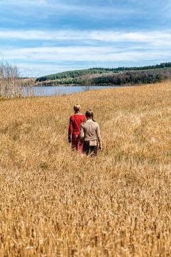 Stephen Mulcahey TWO GIRLS IN WHEAT FIELD BY LAKE Children