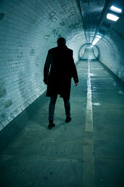 CollaborationJS MAN IN COAT WALKING IN TUNNEL Men