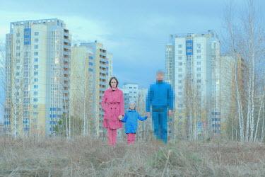 Alexander Kuzovkov FAMILY HOLDING HANDS NEAR HIGH-RISE FLATS Groups/Crowds