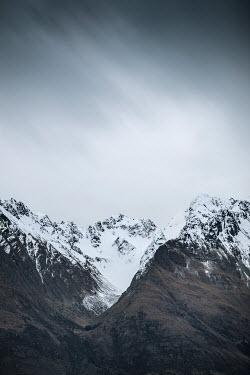 Evelina Kremsdorf SNOWY MOUNTAINS WITH GREY SKY Rocks/Mountains