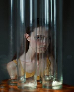 Filipp Rabachev GIRL BEHIND GLASS VASES STARING Women