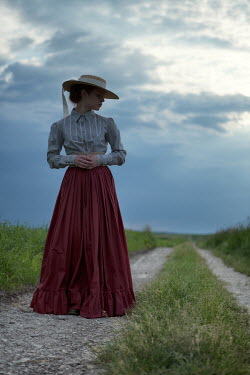 Magdalena Russocka historical woman standing on country path