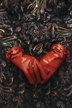 Shelley Richmond CLOSE UP OF FEMALE HANDS IN RED GLOVES Women