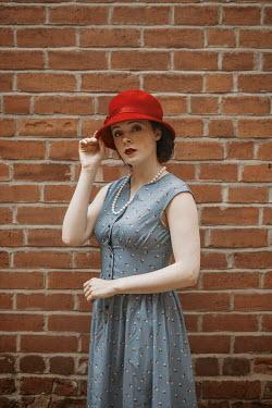 Shelley Richmond RETRO WOMAN IN HAT STANDING OUTDOORS Women