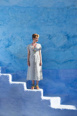 Holly Leedham WOMAN STANDING ON WHITEWASHED STEPS Women