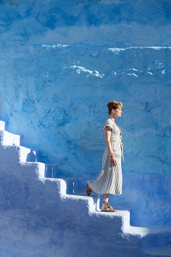 Holly Leedham WOMAN WALKING DOWN WHITEWASHED STEPS Women