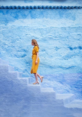 Holly Leedham WOMAN IN YELLOW DRESS CLIMBING STONE STEPS Women