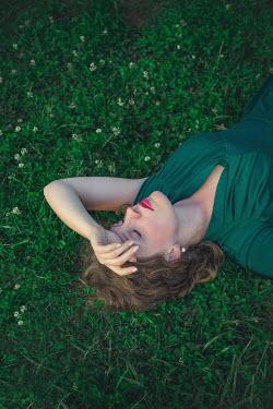 Joanna Czogala WOMAN SLEEPING ON GRASS Women