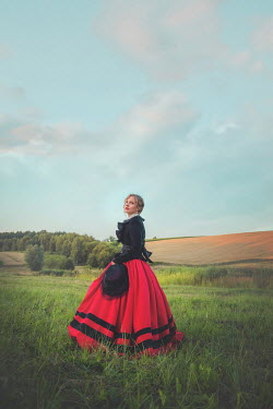 Joanna Czogala HISTORICAL WOMAN STANDING IN FIELD Women
