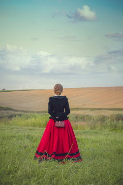 Joanna Czogala HISTORICAL WOMAN HOLDING BOOK IN FIELD Women