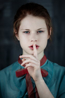 Magdalena Russocka young woman with finger on lips