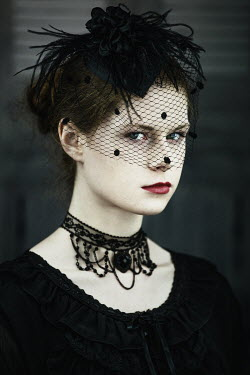 Magdalena Russocka serious young woman wearing black veil staring inside