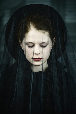 Magdalena Russocka young woman wearing black bonnet with veil inside