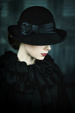 Magdalena Russocka young woman wearing black hat inside
