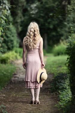 Magdalena Russocka retro blonde woman standing in garden