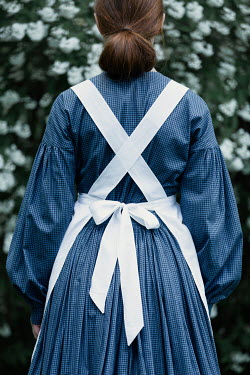 Magdalena Russocka historical housemaid standing in garden