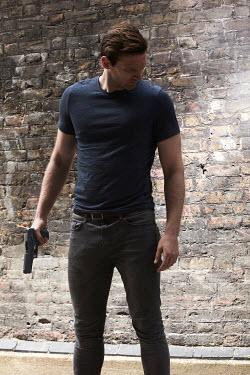 CollaborationJS MAN IN T-SHIRT HOLDING GUN Men