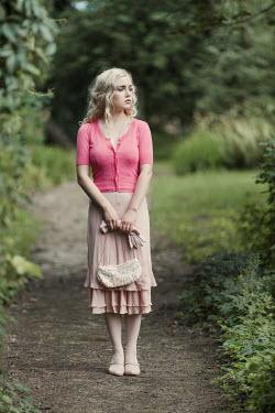 Magdalena Russocka retro woman standing in garden