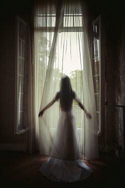 Eva Van Oosten GHOSTLY WOMAN IN WHITE DRESS BY WINDOW Women