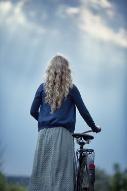 Magdalena Russocka young blonde woman with bike in field