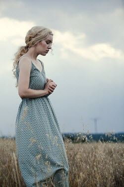 Magdalena Russocka sad blonde woman standing in field