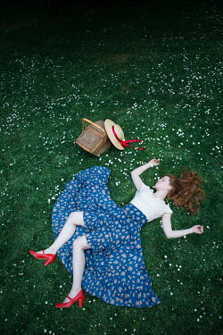 Magdalena Russocka young woman lying on grass Women