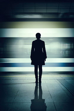 Magdalena Russocka silhouette of woman standing by moving train