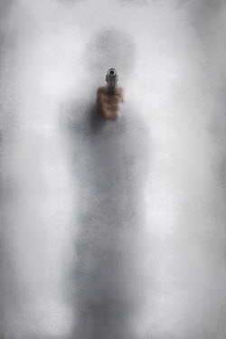 Alex Maxim blurred man in silhouette pointing a gun behind hazy glass