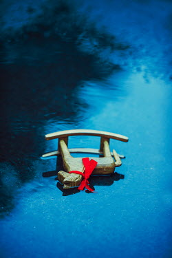 Ildiko Neer Wooden rocking horse in puddle