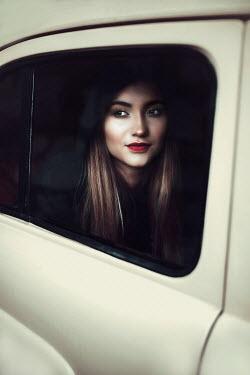 Ildiko Neer Young woman behind car window