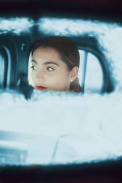 Ildiko Neer Woman reflected in car mirror