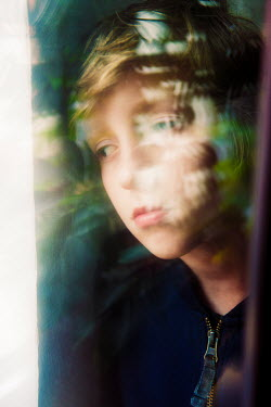 Katya Evdokimova Sad boy behind window Children
