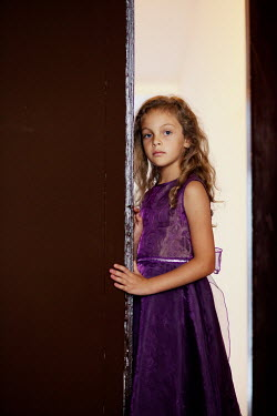 Kerstin Marinov Girl with purple dress in doorway Children