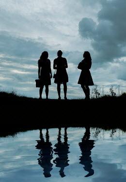 Stephen Mulcahey silhouette of three woman  talking