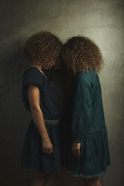 Robin Macmillan Girls with curly hair standing face to face Children