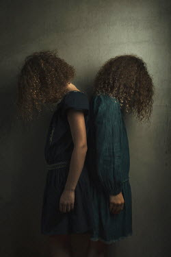 Robin Macmillan Girls with curly hair standing back to back Children