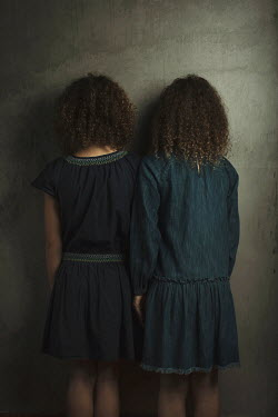 Robin Macmillan Girls with curly hair standing side by side Children
