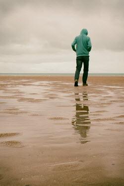 Tim Robinson Man in green hoodie on beach Men