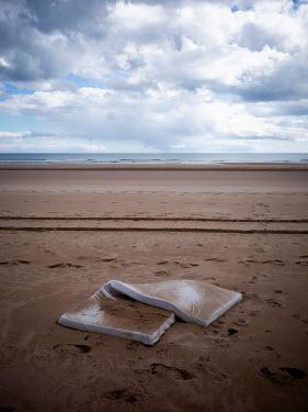 David Baker Discarded mattress on beach Seascapes/Beaches