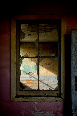 David Baker Broken window in abandoned house Building Detail