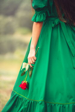Joanna Czogala Young woman in green dress with rose Women