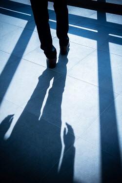 Mohamad Itani Legs of businessman walking on tile floor Men
