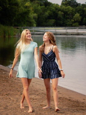 Elisabeth Ansley TWO WOMEN WALKING BAREFOOT ON SAND Women