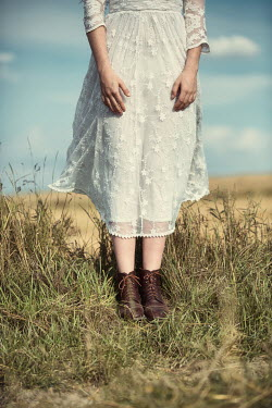 Magdalena Russocka close up of legs of young woman standing in field
