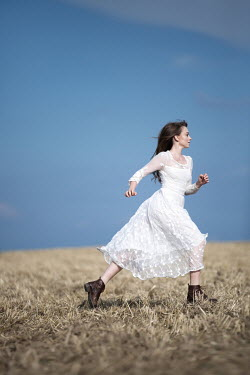 Magdalena Russocka young woman running in field