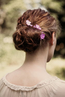 Magdalena Russocka close up of woman with flowers in her hair