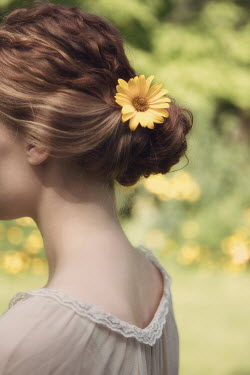 Magdalena Russocka close up of woman with flower in her hair